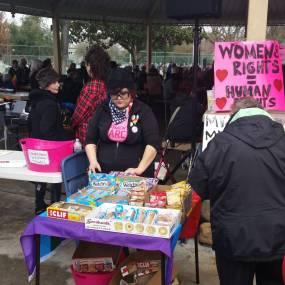 Protest volunteer organizing snacks.