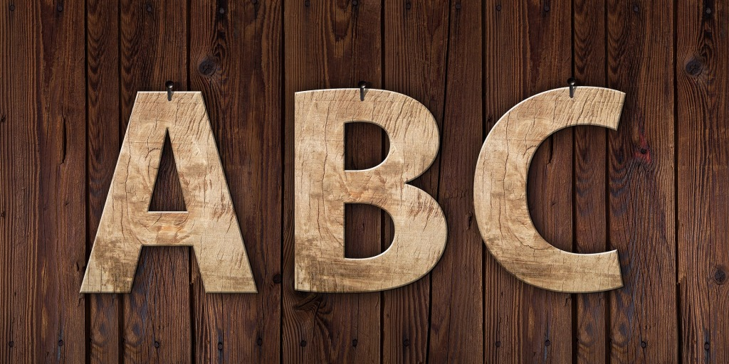 Wooden letters A, B, and C hung on a wall